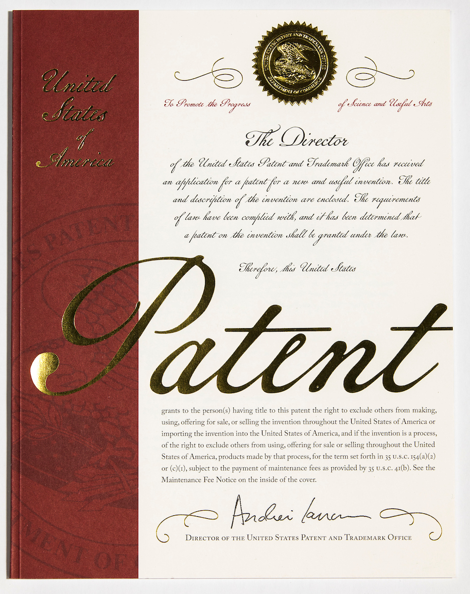 LOCATION: Alexandria, VA DATE: March 11, 2018 -- The United States Patent and Trademark Office (USPTO) unveiled a new design for the U.S. patent cover on March 11 at South by Southwest in Austin, Texas. The new design will be issued later this year beginning with patent number 10,000,000. Created by a team of in-house USPTO designers, this is only the second revision to the document in the past hundred years. CREDIT: USPTO